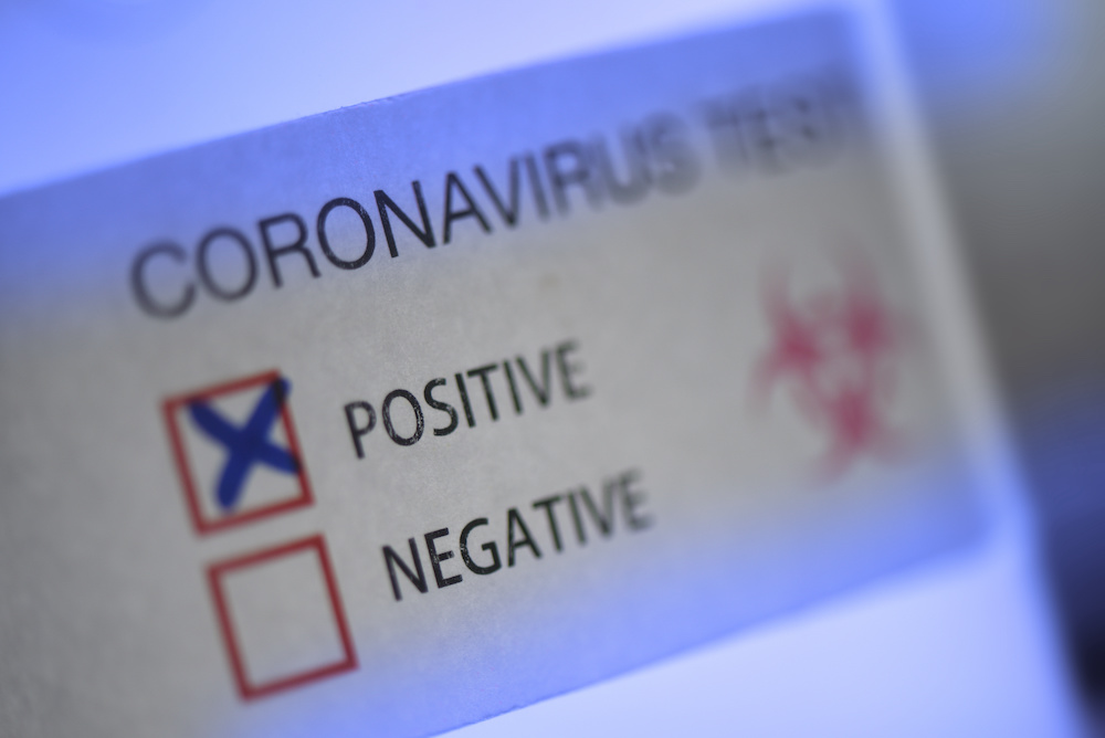 What to Do If You Test Positive for COVID While Traveling Internationally